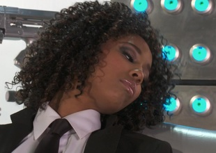 Black girl Misty Stone copulates a long toy into her love tunnel