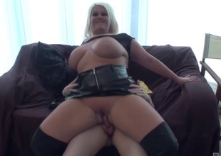 Juicy blonde with big breasts goes naked and rides the jock