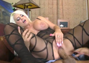 Busty blonde in sexy body fishnet Jacky Joy rides her man face to face