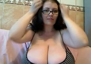 Brunette nerdy beauty is blessed with gigantic pair of breasts