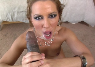 A white girls sucks large black cock and gets a sticky nut as a reward