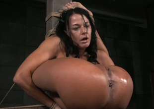Fixed in a crazy pose tanned brunette bitch receives her anus screwed with toy