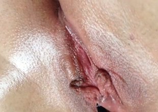 Close-up view of my enjoyable pink shaved pussy teased with brush
