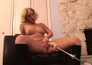 Fabulous solo model in stockings jams an insertion up her pussy by a fuck machine.