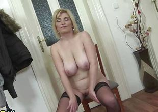 Mature blonde plays with her warm bawdy cleft