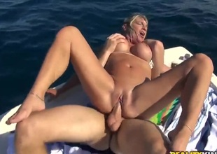Huge tits bounce on a boat