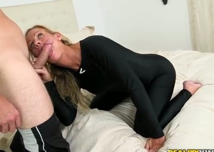 Levi is on the bed with a hot milf. The blonde pornstars is trying to sell him a boat, so she is doing the best she can to sweeten the deal. Check her out.