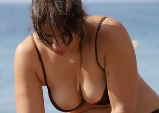 Curvy milf with great cleavage at the beach