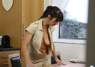 Kitchen cleaning girl does it with her breasts stripped
