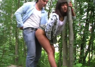 Nasty amateur slut fools around with two lascivious dudes outdoors